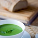 bowl of pea green herbal soup