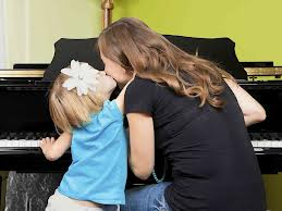 child and parent at piano