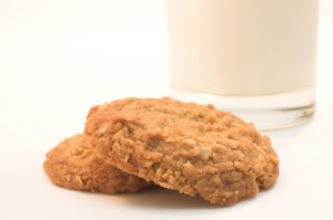 Oatmeal cookies and a glass of milk.