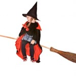 Halloween girl witch on broomstick