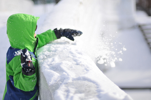 child playing in snow - photopin