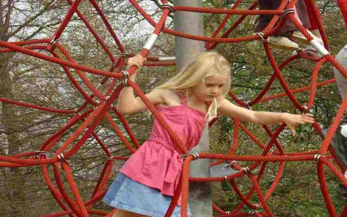 girl climbing at playground