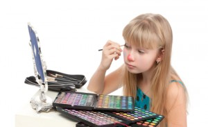 girl playing with makeup