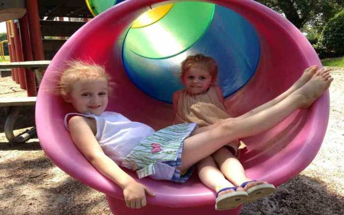 girls on slide at playground