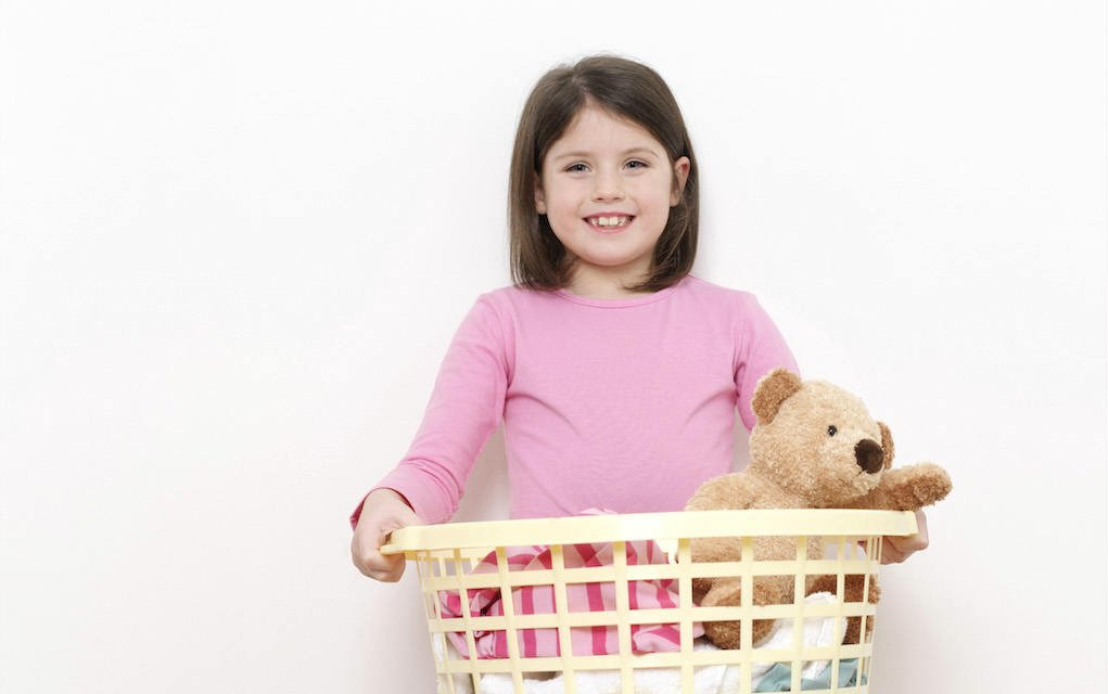 teach your children new responsibilities Little girl with laundry - chores for kids