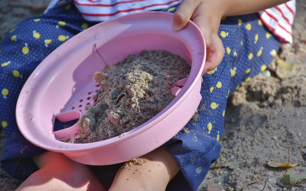 gold panning child playing in sand outdoor activities