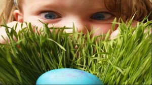 girl peeking at easter egg