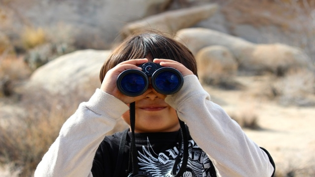 kid with binoculars