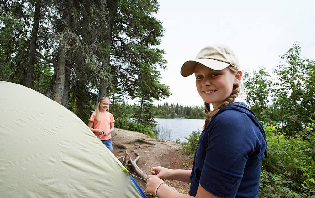 Two girls at their tent for camping with kids