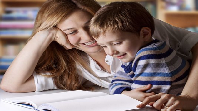 mum and boy reading together