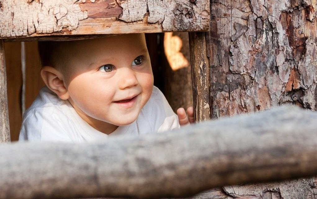 toddler playing hide and seek outdoor activities