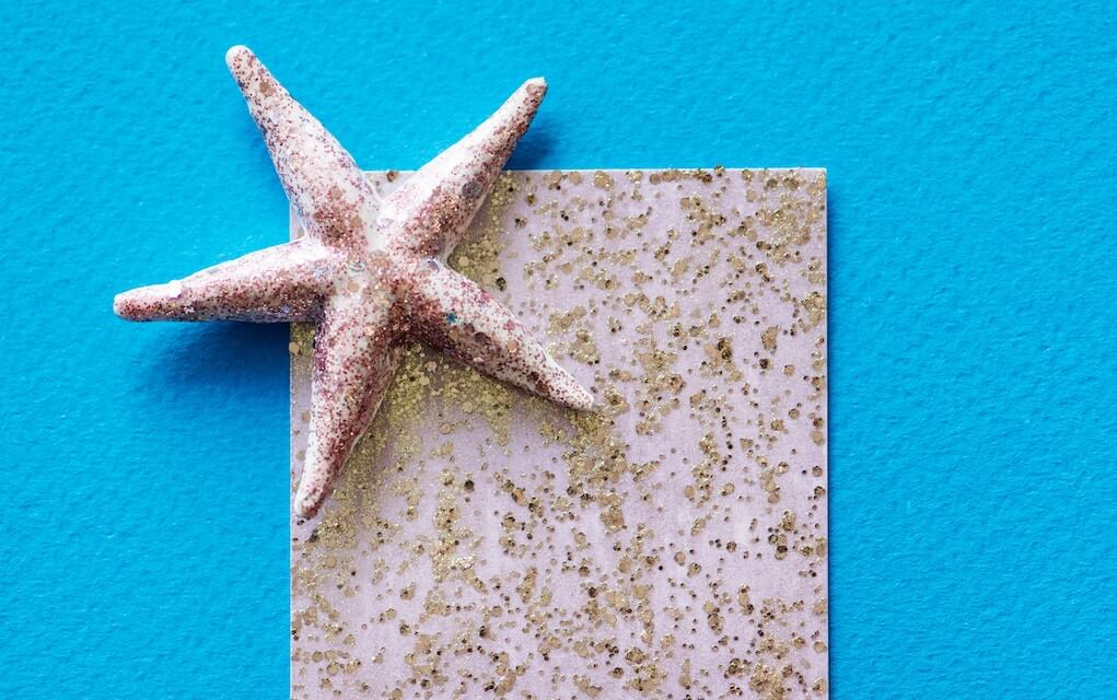 Glitter and sand on a card for beach craft ideas