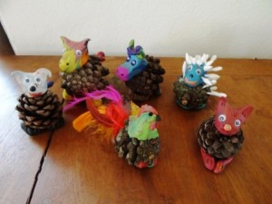 12 perfectly simple pine cone crafts kids can treasure for Pine cone art projects