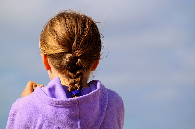 child with hair tied up