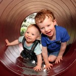brothers-climbing through tunnel