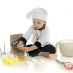 dreamstime_kid - cooking cracking eggs