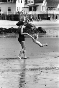 mother and child on beach 1950s