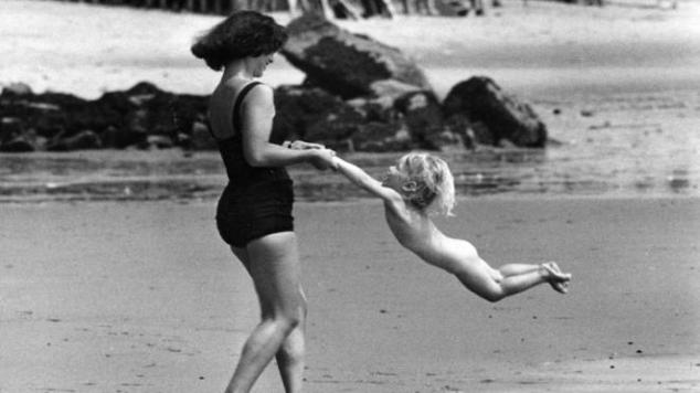 mum and child on beach 1950s