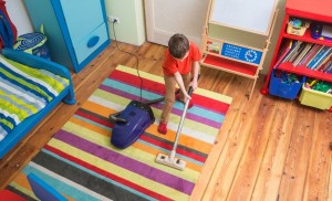 boy vacuuming