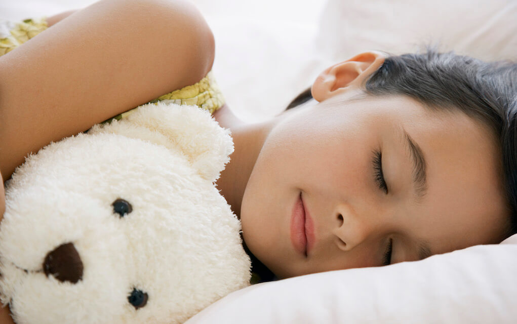 Girl sleeping with teddy bear for keeping your child healthy