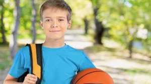 Pupil Insurance boy with bag and ball