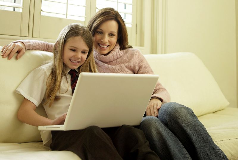 child and mother at laptop