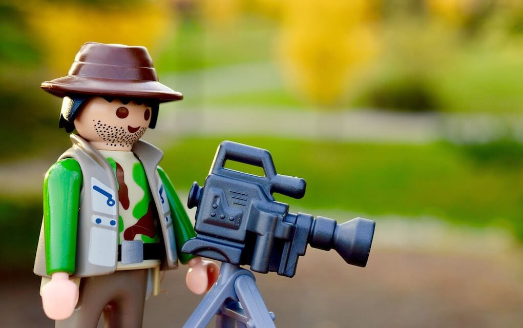 stop motion animation LEGO man with camera on tripod