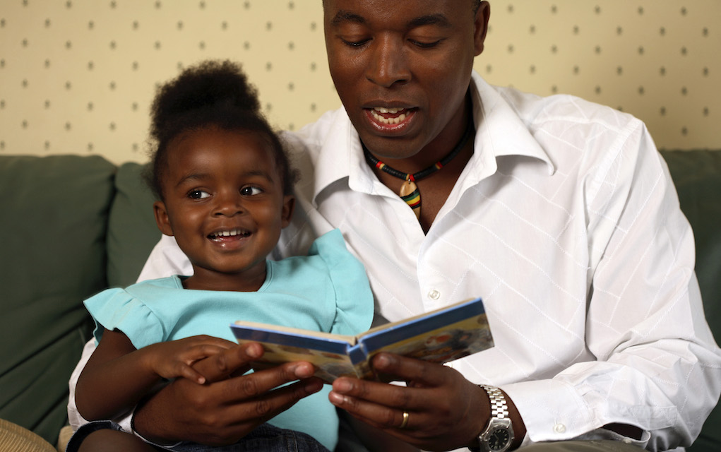 parenting father and daughter reading