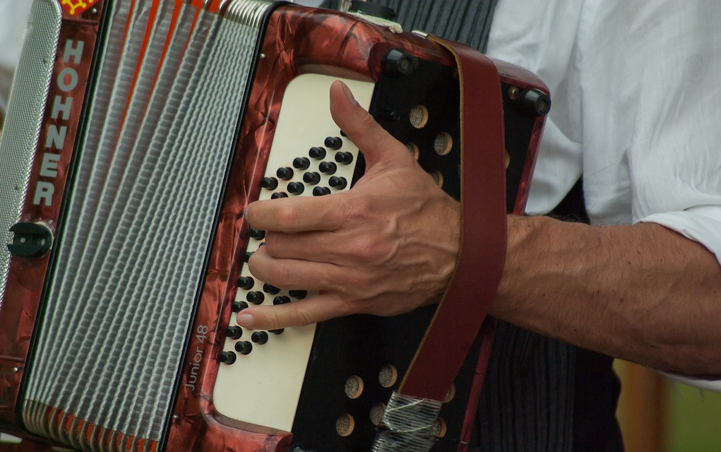Musician playing accordian St Patrick's Day Weekend events