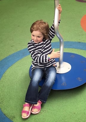 best playgrounds in Ireland girl on a roundabout