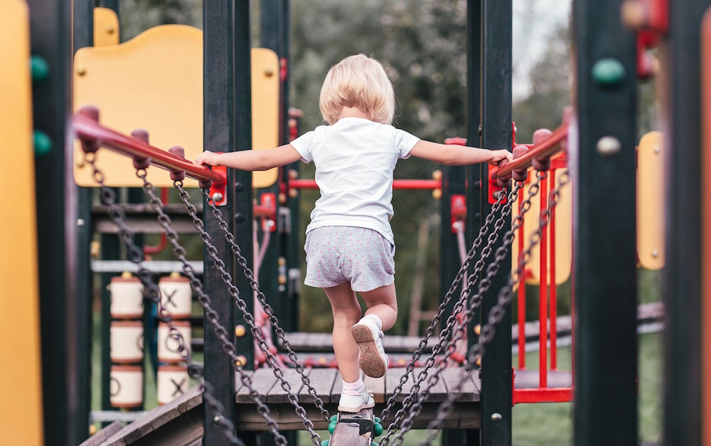 girl on a climbing frame in a playground best playgrounds Ireland