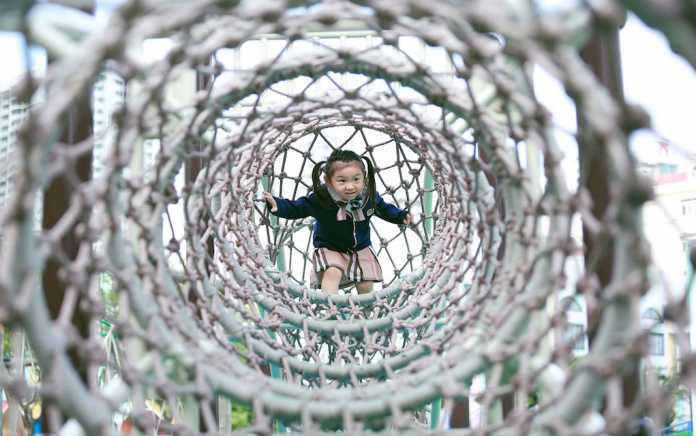 best playgrounds in Ireland girl playing on climbing frame