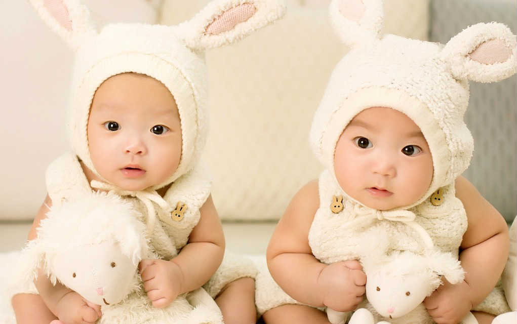Twin babies in bunny costimes