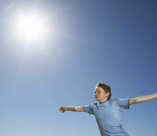 Measure solar energy fun science experiments for kids to try at home boy standing in sun