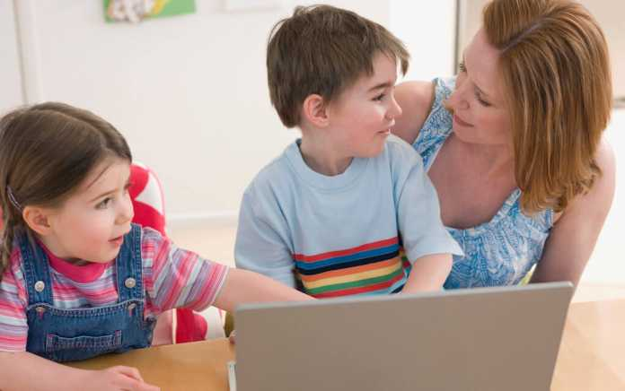 Mum and kids at laptop for grow your business