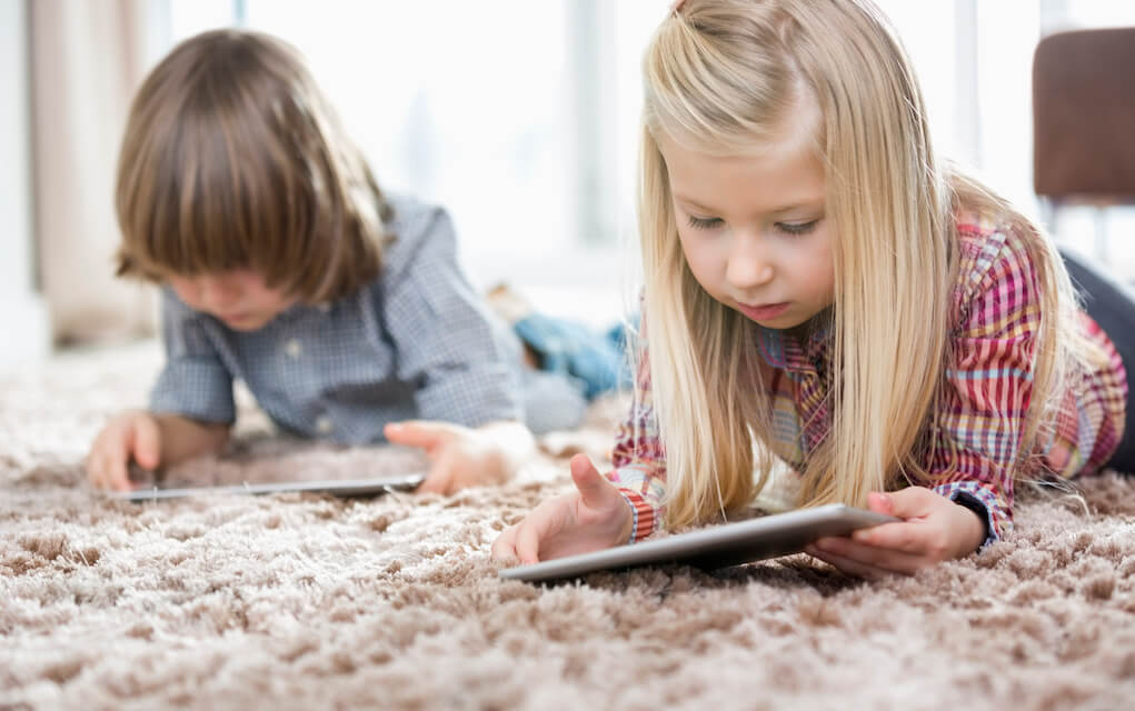 Girl and Boy on tablets for Quality screen time