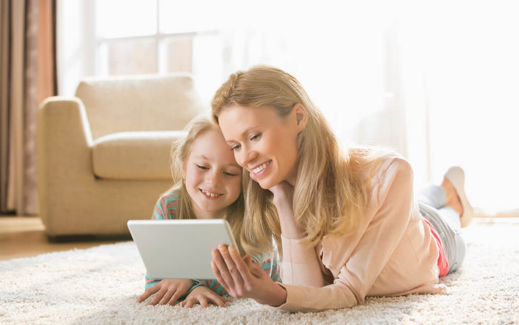 Mum and daughter on tablet together for quality screen time