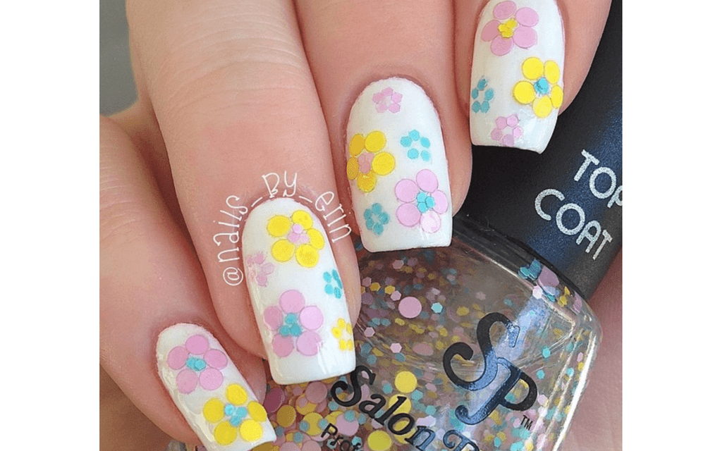 Pastel flowers on white nails