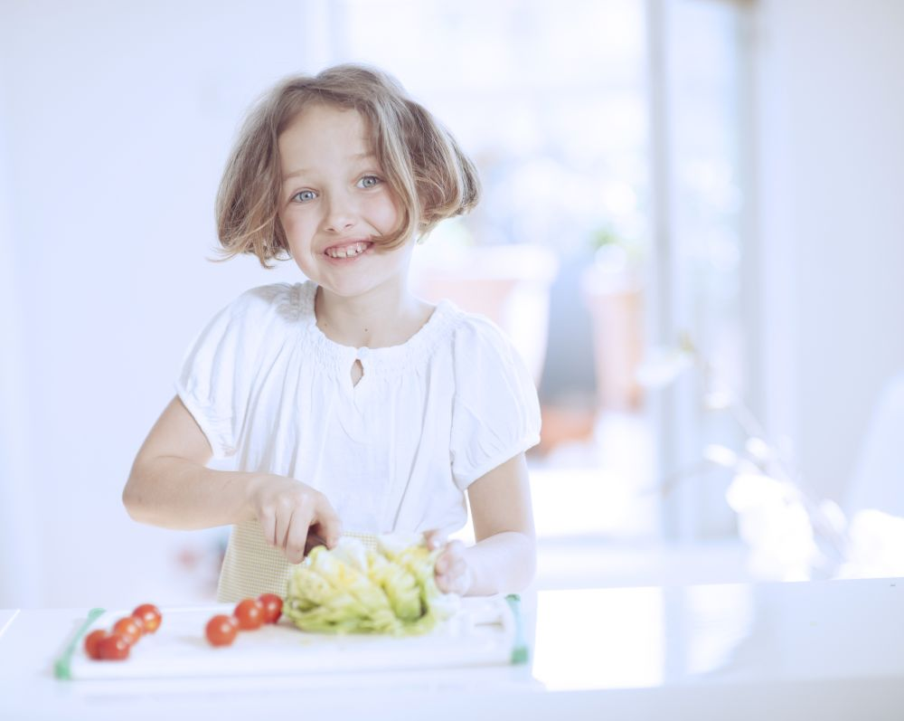 girl chopping salad