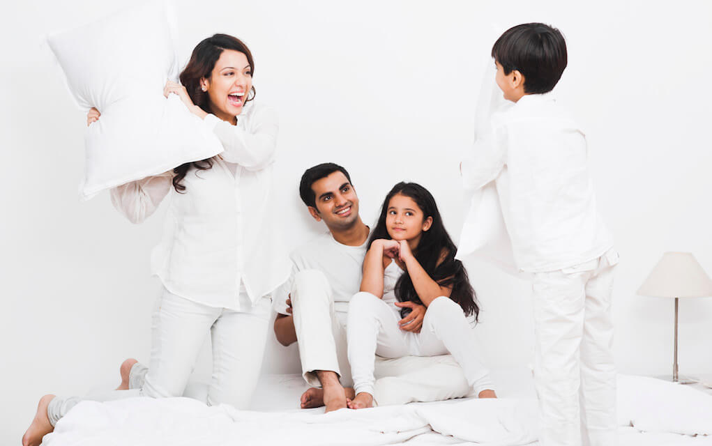 Family having a pillow fight for Yes Day tips