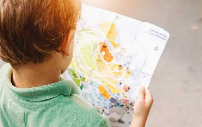Boy reading map for family friendly museum in Britain