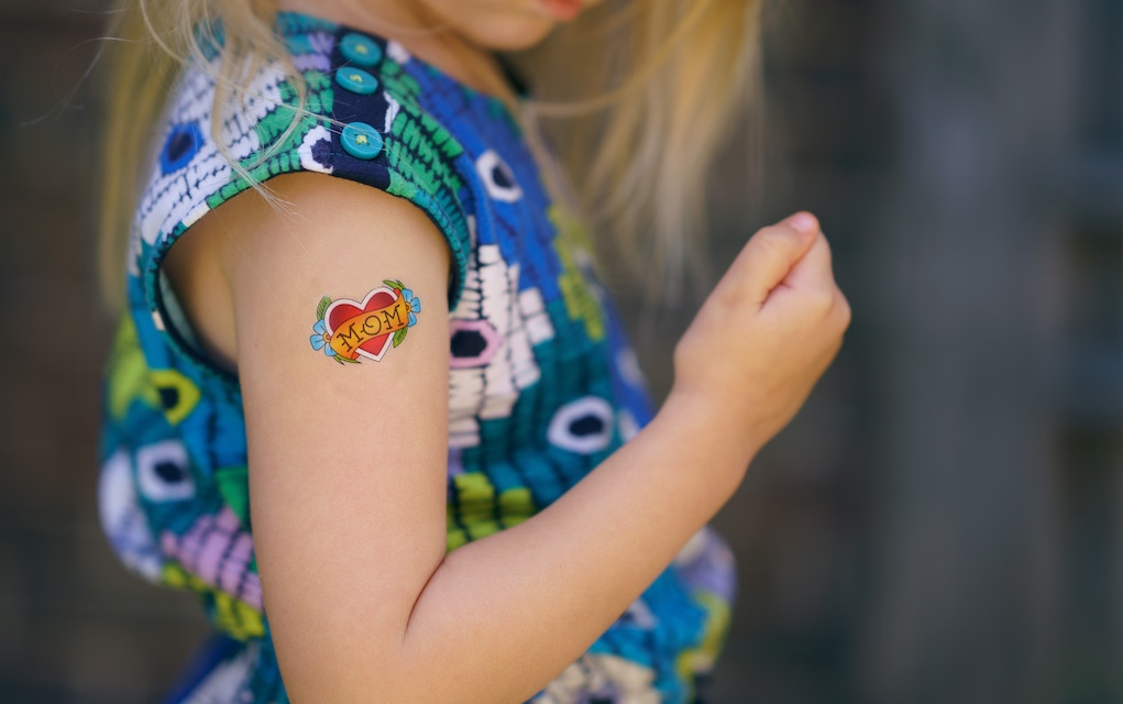 Girl with tattoo on her arm for Yes Day tips