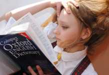 secondhand school books girl reading dictionary