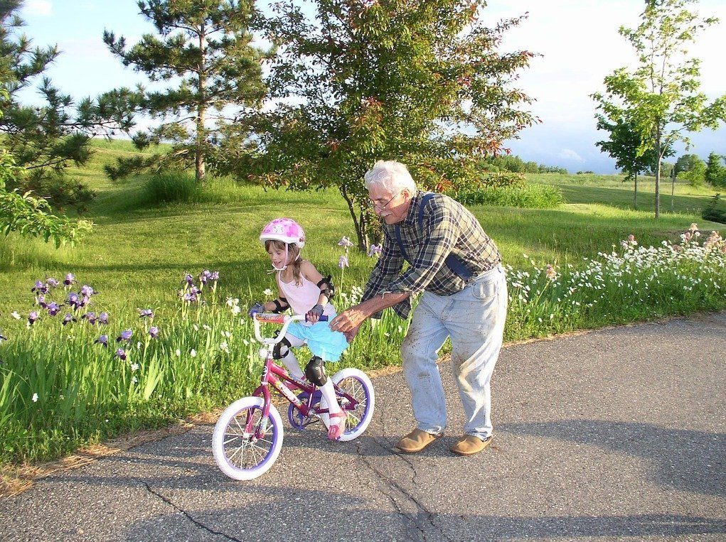 what to do if grandparents are interfering with parenting grandparent teaching child to cycle