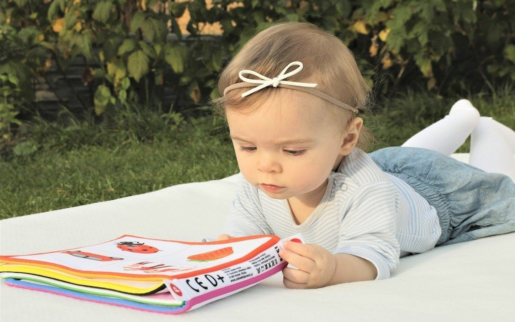 child reading picture book french for kids