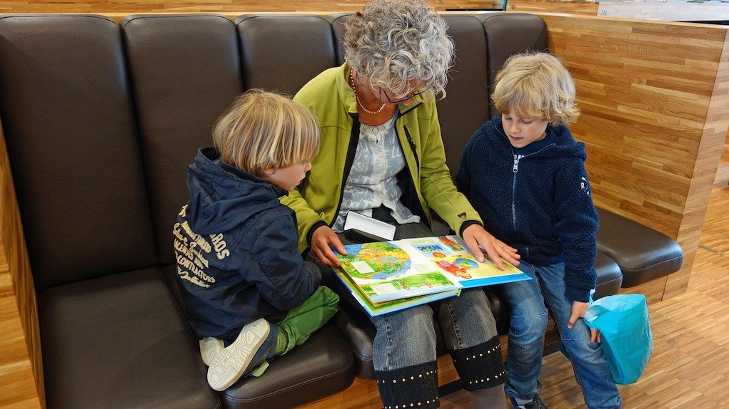 randmother reading to kids grandparent what to do if grandparents are interfering with parenting