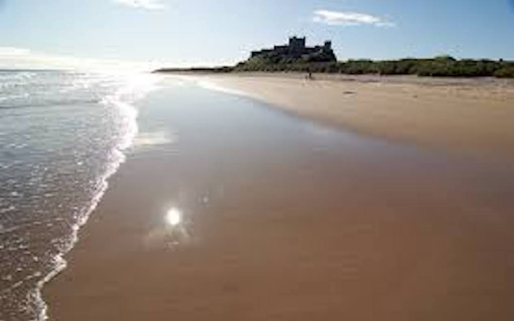 Bamburgh beach for best beaches in UK - Mykidstime