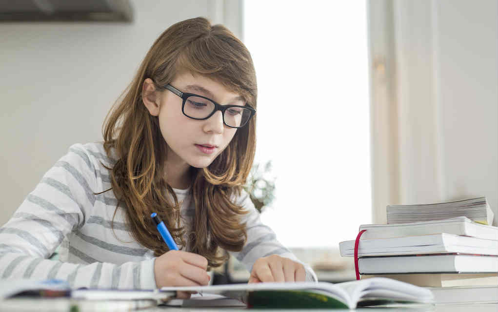 Teenager studying for Parenting teens - Mykidstime