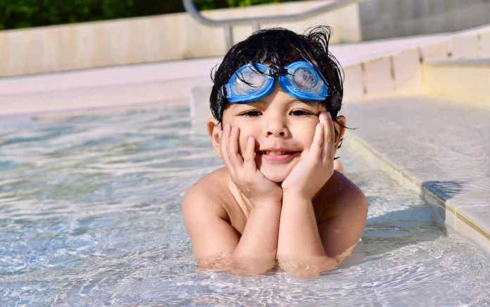 Boy outdoor swimming