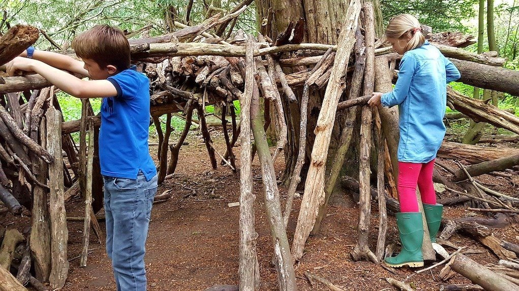 children building an outdoor fort or den eco friendly activities to amuse the kids